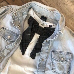 A shirt, a jacket and jeans.